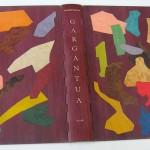 RABELAIS François, Gargantua, illustré par CLAVE, Les Bibliophiles de Provence, S.L 1955 , exemplaire 120/200 39 X 30 X 6 CM , BOIS D'AMARANTE, CHARNIERES OUVRANT SUR L'ARRIERE, DECOR FAIT D'INCRUSTATION PAR FUSION DE DIFFERENTS BOIS NATUIRELS ET TEINTES SUR FOND D'AMARANTE. (RELIURE 2007)